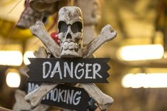 Object with a skull and the inscription danger stock photography