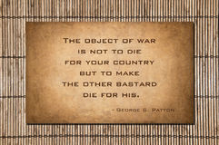 The object of war. Is not to die for your country but to make the other bastard die for his. Quote by George S. Patton. Quote over stone and bamboo Royalty Free Stock Photos