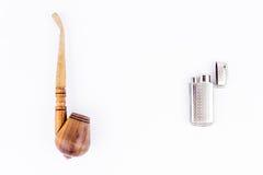 Objectez la photographie d'un lighterand un tuyau de tabac photos stock
