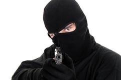 Objectifs masqués d'homme avec le canon Photographie stock libre de droits