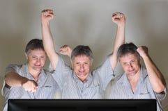 Objectivas triplas Cheering Fotografia de Stock