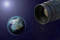 Objective and earth. Objective in cosmos make shot of earth stock photo