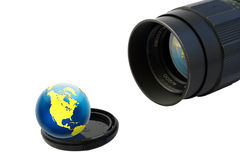 Objective and globe on lens cup Stock Photos