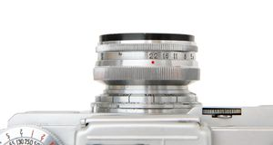 Objective lens of vintage  film camera isolated. Objective lens of vintage 35mm film rangefinder camera  closeup isolated Stock Photo