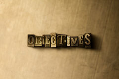 OBJECTIVES - close-up of grungy vintage typeset word on metal backdrop. Royalty free stock illustration.  Can be used for online banner ads and direct mail Stock Photos