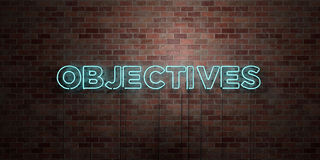 OBJECTIVES - fluorescent Neon tube Sign on brickwork - Front view - 3D rendered royalty free stock picture. Can be used for online banner ads and direct Stock Images