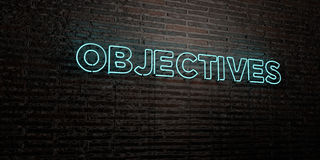 OBJECTIVES -Realistic Neon Sign on Brick Wall background - 3D rendered royalty free stock image. Can be used for online banner ads and direct mailers Royalty Free Stock Images