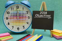 2018 objectives. Written on a small blackboard Stock Photos