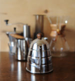 Objects for alternative coffee brewing on a wooden background Royalty Free Stock Image