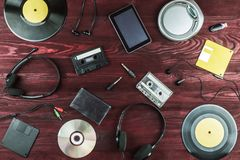 Objects for audio recordings. On a red background Royalty Free Stock Image