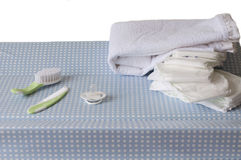 Objects for baby care. Changing table with different objects for baby care Royalty Free Stock Photo