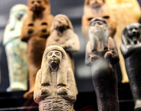 Objects of the dead. Egyptian funeral figurines in a museum Royalty Free Stock Photography