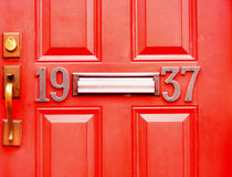 Objects-Doors with Numbers 1937 in Red. With Mailbox Opening Royalty Free Stock Images