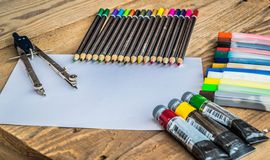Objects for drawing and painting, crayons, tempera, crayons, compass Stock Image