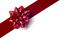 Objects - Gift Wrapping. Red ribbon and red bow isolated against a white background. Gift wrapping for christmas, birthday, or any celebration stock photography