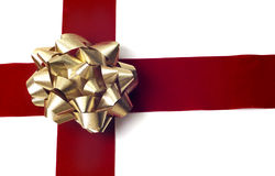 Objects - Gift Wrapping. Red ribbon and red bow isolated against a white background. Gift wrapping for christmas, birthday, or any celebration royalty free stock images