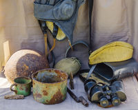 Objects of the Great Patriotic War. Helmet, headset, bowler, glasses, cup, field cap, canteen, ammunition, a bayonet. Photographed in Russia, in the city of Royalty Free Stock Photos