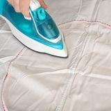Objects Hands action - Hand ironing by the electric iron. Objects Hands action - Closeup hand worker ironing by the electric iron white fabric Royalty Free Stock Image