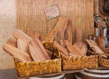 Many kitchen cutting boards and graters for parmesan in wicker b royalty free stock image