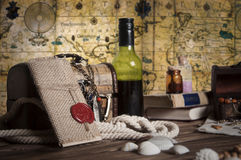 Objects with map on the backgrond. Pirate objects, pirates booty, pirate still life, chest with a antique jewelry, knot letter with sealing wax on the wooden Stock Photography
