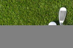 Objects for playing golf lie on the green grass. Objects for playing golf lie on green grass royalty free stock photography