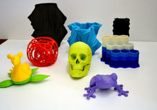 Objects printed by 3d printer on white background. Bright colorful object. Automatic three dimensional 3d printer performs plastic modeling. Modern 3D printing stock images