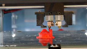 Automatic 3D printer performs red color plastic modeling objects. Objects red color printed by 3d printer. Fused deposition modeling, FDM. Progressive modern stock footage