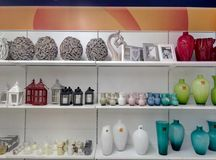 Objects in store display. Objects on the shelves of a store, vases and lanterns still life Stock Photo