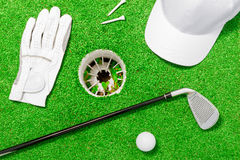 Objects such as golf course lie on the green grass. Near the hole view from above stock image