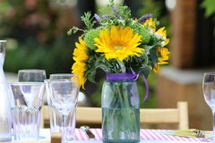 Objects: Sunflower arrangement on the table for a party Stock Images