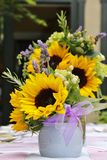 Objects: Sunflower arrangement on the table for a party Royalty Free Stock Photography