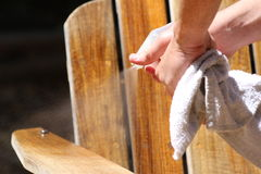 Objects: Teak wood chair being refinished, man spraying Royalty Free Stock Photos