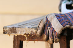 Objects: Teak wood table being refinished, man hand. Royalty Free Stock Images