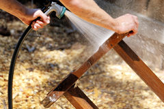 Objects: Teak wood table being refinished, man spraying 2 Stock Images