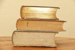 Objects: Three vintage books stacked - side Royalty Free Stock Images