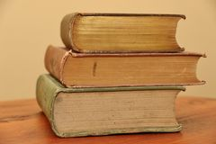 Objects: Three vintage books stacked - sideways Stock Image