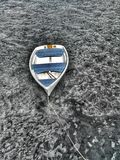 Objects: White boat, blue seats and a black/white lake Royalty Free Stock Images
