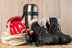 Objects for winter extreme trekking on a wooden Royalty Free Stock Image