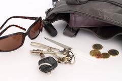 Objects in a woman's bag royalty free stock photography