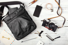 Objects on wooden background: leather bag, camera, smartphone Royalty Free Stock Photography
