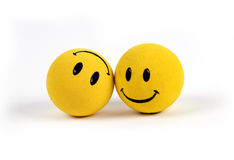 Objects - Yellow Smiley Faces. Two round smiley faces - one with a smile, one upside down with a frown Royalty Free Stock Photo