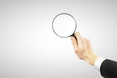 Objektiv in der Hand Stockfotografie