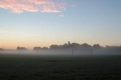 Objetivo do futebol do amanhecer imagens de stock royalty free