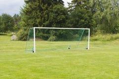 Objetivo do futebol na grama verde Imagens de Stock Royalty Free