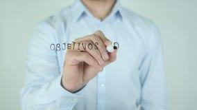 Objetivos de negocio, metas de negocio escribiendo en español en el vidrio metrajes