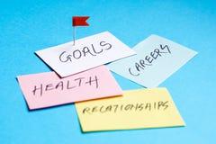 Objetivos nas carreiras, na saúde e nos relacionamentos fotos de stock