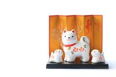 Objeto japonés del perro del Año Nuevo aislado en blanco Imágenes de archivo libres de regalías