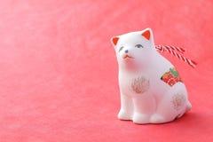 Objeto japonés del perro del Año Nuevo en rojo Imagen de archivo