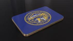 Objeto lustroso da bandeira de Nebraska 3D isolado no fundo preto fotografia de stock