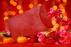 Objetos chinos del Año Nuevo en fondo rojo Fotos de archivo libres de regalías